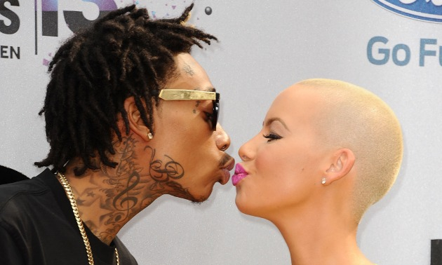Wiz Khalifa and Amber Rose Kissing Getty