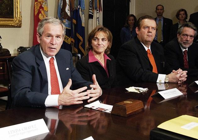 US President George W. Bush (2nd L) spea