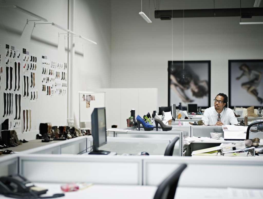 Designer sitting at desk looking at samples