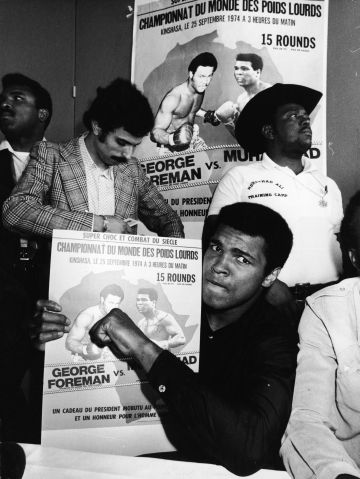 Muhammad Ali Holds Poster For Foreman Bout
